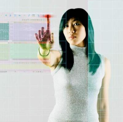 Young Woman Using A Touch Screen Interface