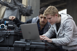 Two Men on a Film Set Using Precision M3800 Mobile Workstation and Red Digital Cinema Camera