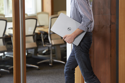 Man Walking into Conference Room with Notebook