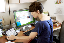 Woman Using Venue 11 Pro 7000 Series Tablet and Peripherals
